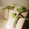 Two rustic present boxes with green leaves